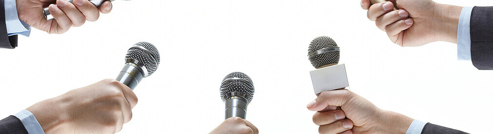 image of hands with microphones